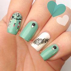 Dreamcatcher and feather nails. (@phenomenail)