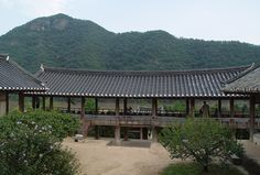 """Byeongsan Seowon in Andong, North Gyeongsang Province, was established in 1613 to pay tribute to the memory of Yu Seong-nyong (1542-1607). It is renowned for its picturesque landscape formed by the Nakdong River in front and Mt. Byeong lying beyond the river. It also features the architectural style of Korean Confucian academies, which seeks the """"unity of heaven and human beings"""" ideology."""