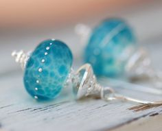 Not usually a big fan of lamp work beads, but these are really pretty.