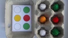 se situer dans l'espace avec une boite d'œuf et des pompon de couleurs
