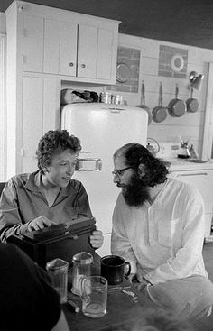 Bob Dylan and Allen Ginsberg inside the kitchen of Dylan's Woodstock home in 1964