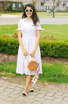 Prettiest eyelet dress that I ever saw! Love the daisy pattern and bow ties sleeves and Gemini look of this summer staple! #DressLover #EyeletDress #SpringDresses #SummerDresses