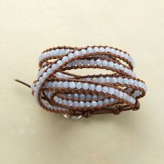 """Blue Mirage 5 Wrap Bracelet  Chan Luu tethers faceted spheres of """"blue mirage"""" quartz to brown leather strands that wraps 5 times at the wrist. Sterling silver button clasp."""