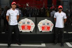(L to R): Jenson Button (GBR) McLaren and Lewis Hamilton (GBR) McLaren with Sparco overalls for auction to raise money for the victims of the recent Emilia Romagna earthquake of last May.  Formula One World Championship, Rd 13, Italian Grand Prix, Practice, Monza, Italy, Friday, 7 September 2012