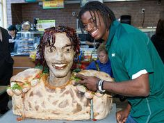 Baylor quarterback Robert Griffin III, the likely 2nd Overall pick in this week's NFL Draft, receiving the ultimate honor: A sculpture of his face at a Subway restaurant made out of 'Smokehouse Barbecue Chicken