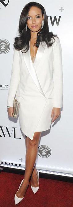 Selita Ebanks in a white Haute Hippie tuxedo dress and matching pumps styled with a metallic clutch