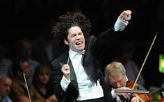 Gustavo Dudamel conducting the Simon Bolivar Orchestra of Venezuela.    I'm gonna say it -- I'm not loving Dudamel -- and I'm SO happy I finally met someone at the last LA Phil concert who also thought that way.