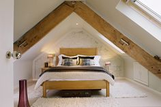 Loft with painted bricks and wooden beam