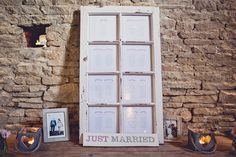 Rustic table plan names by Bonny and Clyde. Photo by Anna Clarke Photography