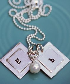 I would love one of these simple and sweet necklaces from The Vintage Pearl. I love family owned businesses, and this is mom-owned. Even better :)