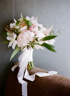 Organic Bridal Bouquet featuring peonies, juliet garden roses, clematis vine, jasmine vine, astilbe, bay leaf and more by Life in Bloom with Frou Frou Chic Ribbon, photo by Kina Wicks