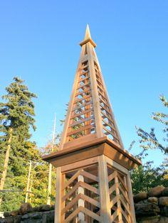 Cedar Tower obelisk with herring bone trellis design.