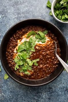 A flavorful, spicy black lentil stew that uses a homemade berbere spice blend paired with black lentils, tomatoes, vegetable broth, and yogurt. Featuring Black Lentils from african food ethiopian recipes Berbere Black Lentil Stew with Yogurt and Cilantro Red Lentil Recipes, Soup Recipes, Vegetarian Recipes, Cooking Recipes, Healthy Recipes, Teff Recipes, Healthy Food, Ethiopian Lentils, Salads