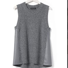 Banana republic faux leather side tank Hi low top with speckled heather gray. Do not dryclean. Made of 78% cotton and 22% polyester. Faux leather sides. Banana Republic Tops Tank Tops