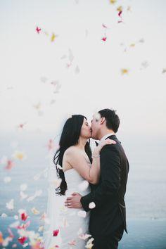 #rose-petals, #kiss  Floral Design: Gloriosa - gloriosabaliwedding.com/ Design and Planning: Paper Diamonds - www.paper-diamonds.com/ Photography: Terralogical - www.terralogical.com/  Read More: http://www.stylemepretty.com/2013/05/08/bali-wedding-from-paper-diamonds/