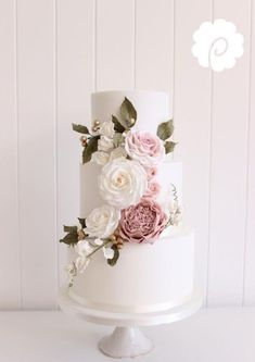 Soft pinks and greens in the florals on this elegant wedding cake are just perfect! #pinkweddingcakes