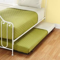 Metal Trundle  | The Land of Nod, $149 is 3.25 inches tall does not pop up and requires a 5 inch trundle mattress...combined mattress and trundle height is 7.5 inches