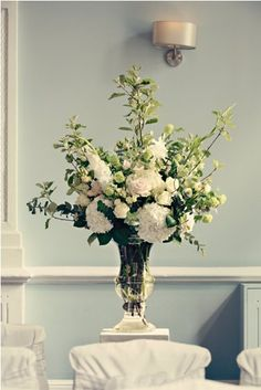 A gorgeous display of summer flowers in a glass urn