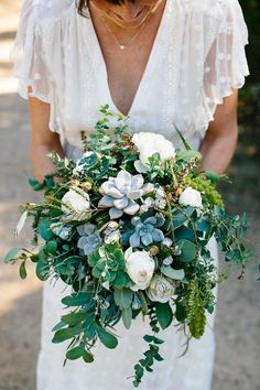 eucalyptus and succulent bouquet - photo by Love Katie and Sarah http://ruffledblog.com/relaxed-backyard-australian-wedding #weddingbouquet #bouquets #succulents  Make this beautiful bouquet using silk flowers from http://www.afloral.com/