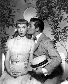 Doris Day & Gordon MacRae! By the light of the silvery moon, I want to spoon,  to my honey I'll croon love's tune. Honeymoon keep a-shining in June, Your silvery beams will bring love dreams, we'll be cuddling soon, by the silvery moon!