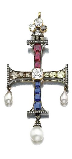 RUBY, SAPPHIRE, PEARL AND DIAMOND CROSS PENDANT, CIRCA 1880 The centre set with a collet-set cushion-shaped diamond, the arms set with variously-cut rubies, sapphires and diamonds of yellow and brownish tints, accented with rose-cut diamonds and pearl drops, to a diamond-set trefoil surmount, fitted case signed Bulgari.
