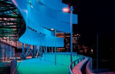 SIMES illuminates the brand new DANUBE ARENA in Budapest, the building that hosted the world swimming championship 2017 (Avenue Urban Lighting by Simes in the photograph). Light Architecture, Budapest, Lighting Design, Fair Grounds, Photograph, Waves, Swimming, Urban, Lights