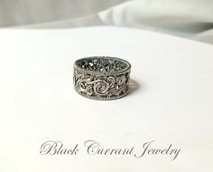 https://www.etsy.com/listing/180090188/size-9-us-sterling-silver-woven-ring?ref=shop_home_active_12