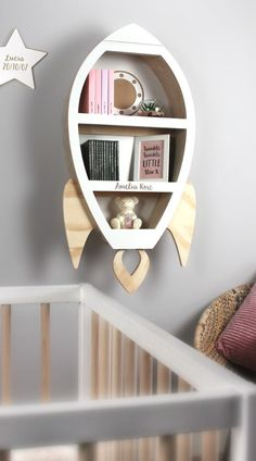 Add a little magic to your child's themed bedroom or nursery with this unique children's rocket shaped wall shelf. A unique solid and sturdy design th.