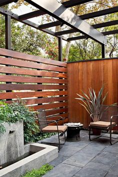 The patio extends to this semi-sheltered space, replete with fountain and abundant greenery.