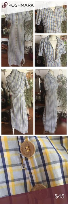 """Vintage Long Cotton Dress A simple yet figure flattering soft yellow, blue & white plaid long dress w wood-look buttons (only the buttons that go to the waist unbutton; the bottom buttons are for show); slightly padded shoulders. No size/fabric/maker tag. Measured flat: shoulder to waist 14-1/2""""; shoulder to bottom 52""""; under arms across chest 18-1/2""""; waist 14-1/2""""; hips 19-1/2""""; Sleeves 9-1/2"""". Measure your body across & compare measurements for fit. In excellent preowned vintage…"""