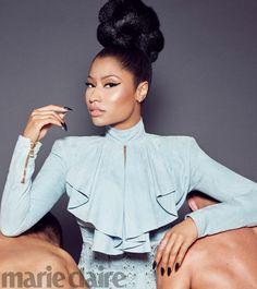Posing with a high top knot hairstyle, Nicki Minaj wears Balmain ruffled top For Marie Claire Magazine November 2016