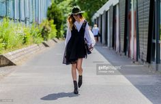 Beatrice Gutu wearing Finders Keepers dress, Edited blouse, vintage bag and shoes, Brixton hat outside Dimitri during the Mercedes-Benz Fashion Week Berlin Spring/Summer 2017 on June 30, 2016 in Berlin, Germany.