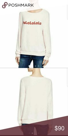 """🎊🎄Wildfox🎄🎊 Falalala Christmas Pullover Jumper Wildfox Couture Baggy Beach Jumper. Keep extra cozy with this super soft long sleeved pale pink fleece sweater with perfectly roomy fit!!! Featuring a fun and festive print that reads""""Falalalala"""" across the front. Rayon/Polyester/Spandex Wildfox Couture Sweaters Crew & Scoop Necks"""