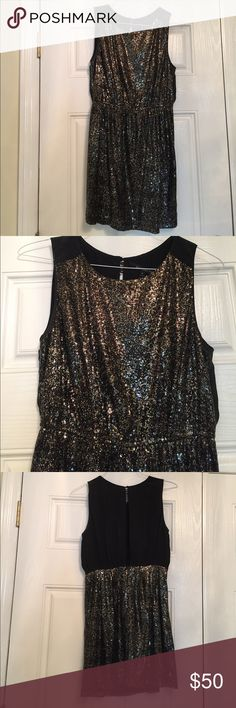Black silk and gold sequin cocktail dress. Elegant and sassy min dress with black silk sleeveless bodice with round neckline embellished with gold, black, and copper round mini sequins on the front and on the back skirt.  Back bodice is an open slit with 4 buttons at neck. Boundary & Co. Dresses Mini