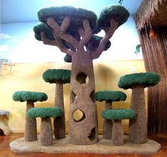 African Baobab Kitty Sanctuary: a giant cat tree with 4 levels and up to 6 small trees on the left and right to accommodate up to 15 cats. Cool Cat Trees, Diy Cat Tree, Cool Cats, Cat Tree Designs, Cat Tree Plans, Cat Castle, Dog Gadgets, Cat Tree House, Giant Cat
