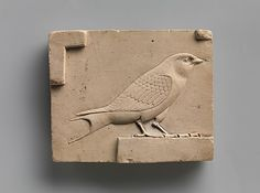 Relief plaque with a swallow Period: Late Period–Ptolemaic Period Date: 400–30 B.C. Geography: Egypt Medium: Limestone