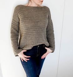 "Making your own clothing is an amazing, scary thing. This free crochet sweater pattern has the ""scared to try a sweater"" crocheters in mind. Every little detail you need to know to succeed is explained. The bell sleeve design adds a trendy flair to a classic sweater."