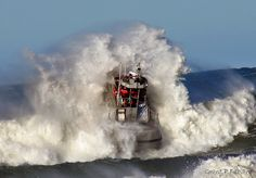 Playing in the waves, the sea rescue crews get a work out off Ocean Beach.      this might be ok
