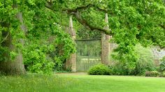 One of two large Wrought Iron Gates set between stone pillars in the Grounds of Barrington Court, Somerset. Barrington Court, Stone Pillars, Wrought Iron Fences, Special Images, Garden Fencing, Night Lamps, Fence Ideas, Around The Worlds, Outdoor Structures