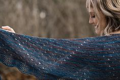 """The design process for this shawl happened very organically. Once I received the beautiful skein of AVFKW's """"Even Tinier Annapurna,"""" I knew I wanted to create a relaxing knit that resulted in a very easy to wear shawl. Garter stitch, polka dot eyelets and my favorite lace border combined to make this one-skein wonder one of my absolutely favorite new knits. I hope you have as much fun knitting it is I have! Thank you so much, A Verb for Keeping Warm, for letting me be a part of this year's…"""