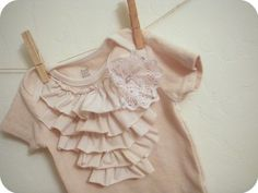 Decorate onesies with ruffles, fabric flowers, iron on or paint.