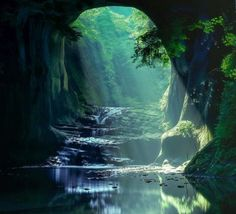 The beautiful picture was taken at Kimitsu City in Chiba Prefecture. Known as Nomizo Waterfall, the clear-running stream travels below a craggy arch and over moss-covered rocks, creating a cool watering hole for locals to swim in during the summer months. The tunnel of light is created at certain times of the day, depending on the season, making for a spectacular sight.