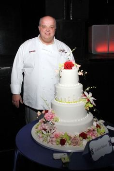 "Mauro from ""Cake Boss"" displaying a wedding cake from Carlo's Bakery at The Wedding Salon bridal event"