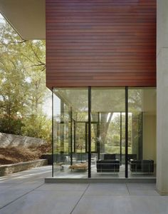 wood panels usage in the exterior and glass, nice combination