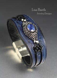 Here is a bracelet with a blue Sapphire focal piece that has a sterling, hand woven bezel. The leather is hand cut, tooled, dyed and then I distressed the finish to give it more character. It has a magnetic clasp and lined with sheepskin for comfort. --Lisa Barth Hard to give up but I have to learn to let go... https://www.etsy.com/listing/225845991/blue-sapphire-leather-bracelet?ref=shop_home_active_2