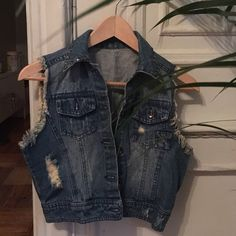 Blue jean vest Clean and never been worn. No damages Tops