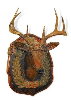 irca 1900 magnificent rustic folk art wood three dimensional deer head mounted to a pine shield, surrounded by a wreath of finely detailed beer hops and acorns and showing authentic antlers fitted beneath hand tooled leather leaves, all hand carved and hand painted in original condition, found in Wisconsin.