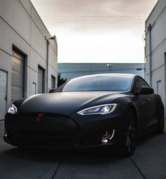 It doesn't get any hotter than this Matte Black Tesla Model S. Great family car.