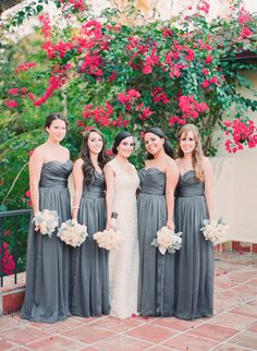 Graceful gray bridesmaid dresses for fall: http://www.stylemepretty.com/2014/09/30/15-beautiful-bridesmaids-dresses-for-fall/ | Photography: Michelle March Photography - michellemarch.com/