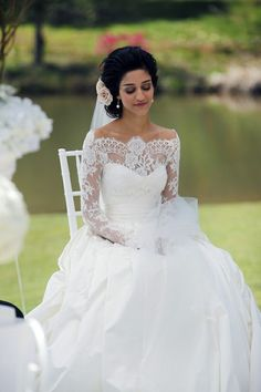 Donna Tobin lace sleeve off the shoulder wedding dress.